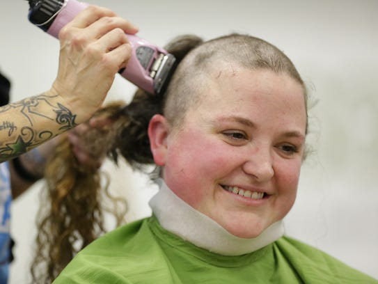 Marjorie Trew-Munson gets her hair shaved off at the