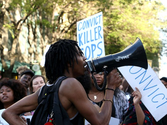 Activists take to the streets of Sacramento to protest the death of Stephon Clark.