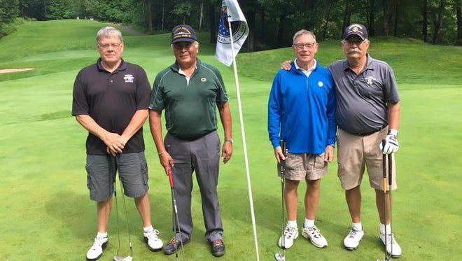 George Dexter, right, of Suamico is pictured with his playing group in a Veteran Golfers Association regional qualifier Aug. 8 at Thornberry Creek at Oneida in Hobart.