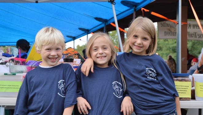 Southern Kettle Moraine Horse Trail Association Jr. members (from left) Mason Reichenberger, Bailey LeRoy, and Caydance McPhail take a break at the annual Fall Roundup.