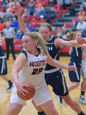 Buckeye Central's Courtney Pifher looks for a way through the Carey defense.
