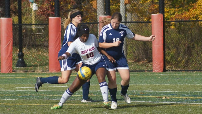 Simone McEnough (No. 10) fights for the ball.