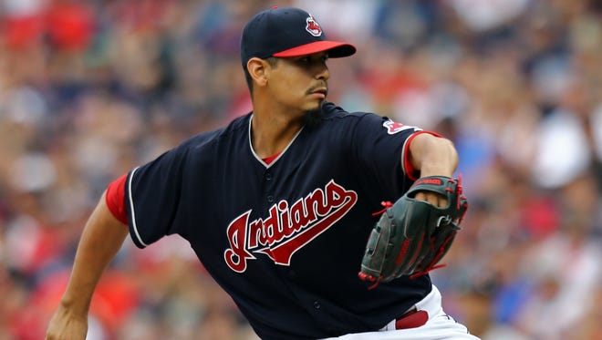 Indians starting pitcher Carlos Carrasco throws a pitcher against the Tigers in the second inning at Progressive Field in Cleveland.