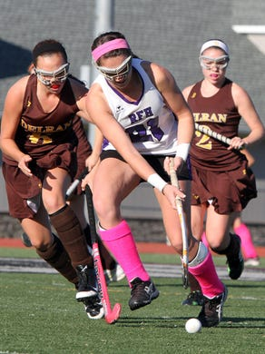 Rumson-Fair Haven's Madison Maguire is challenged by Delran's Rebecca Howard and Alyssa Bayer during the first half at Rumson-Fair Haven High School Monday November 3, 2014.  Staff photo Tanya Breen  ASB 1104 combo