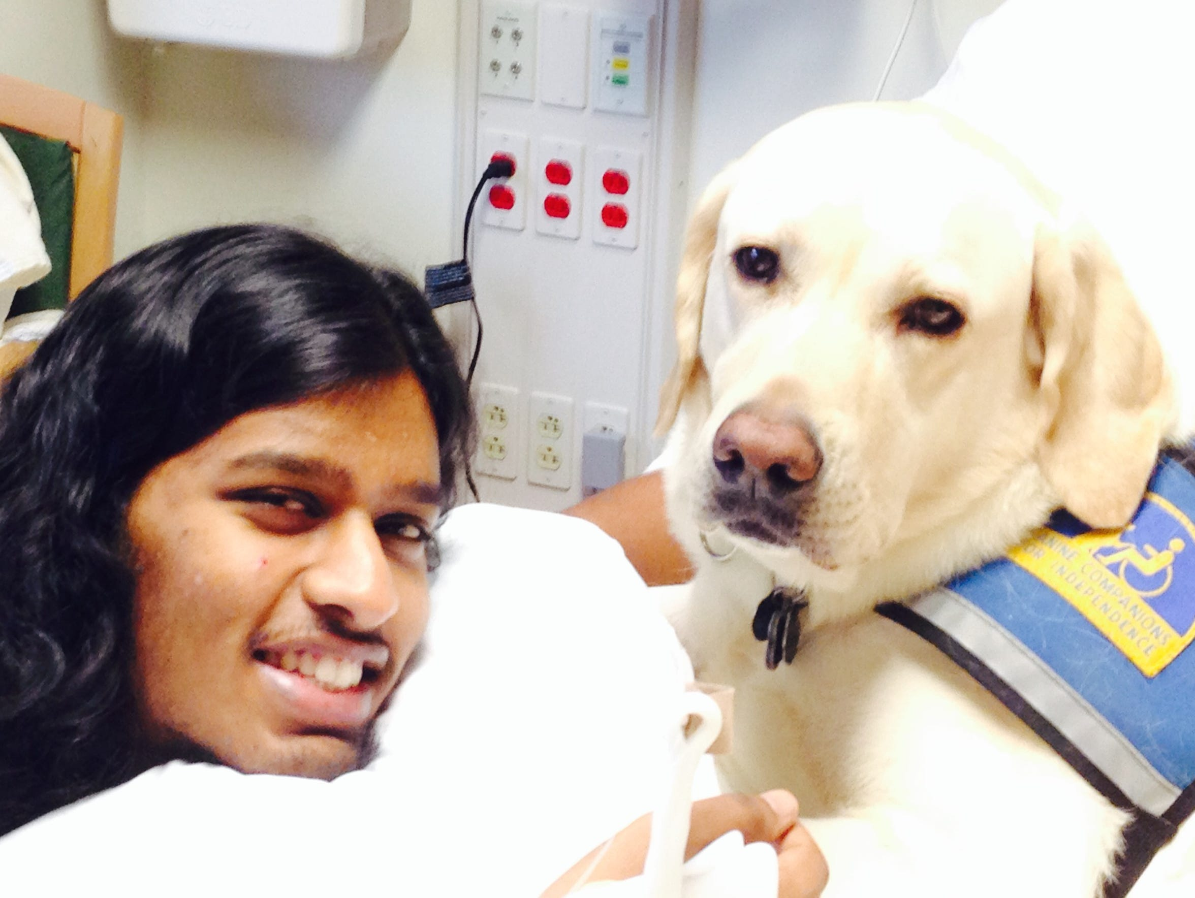 Ronny Ahmed with hospital therapy pet