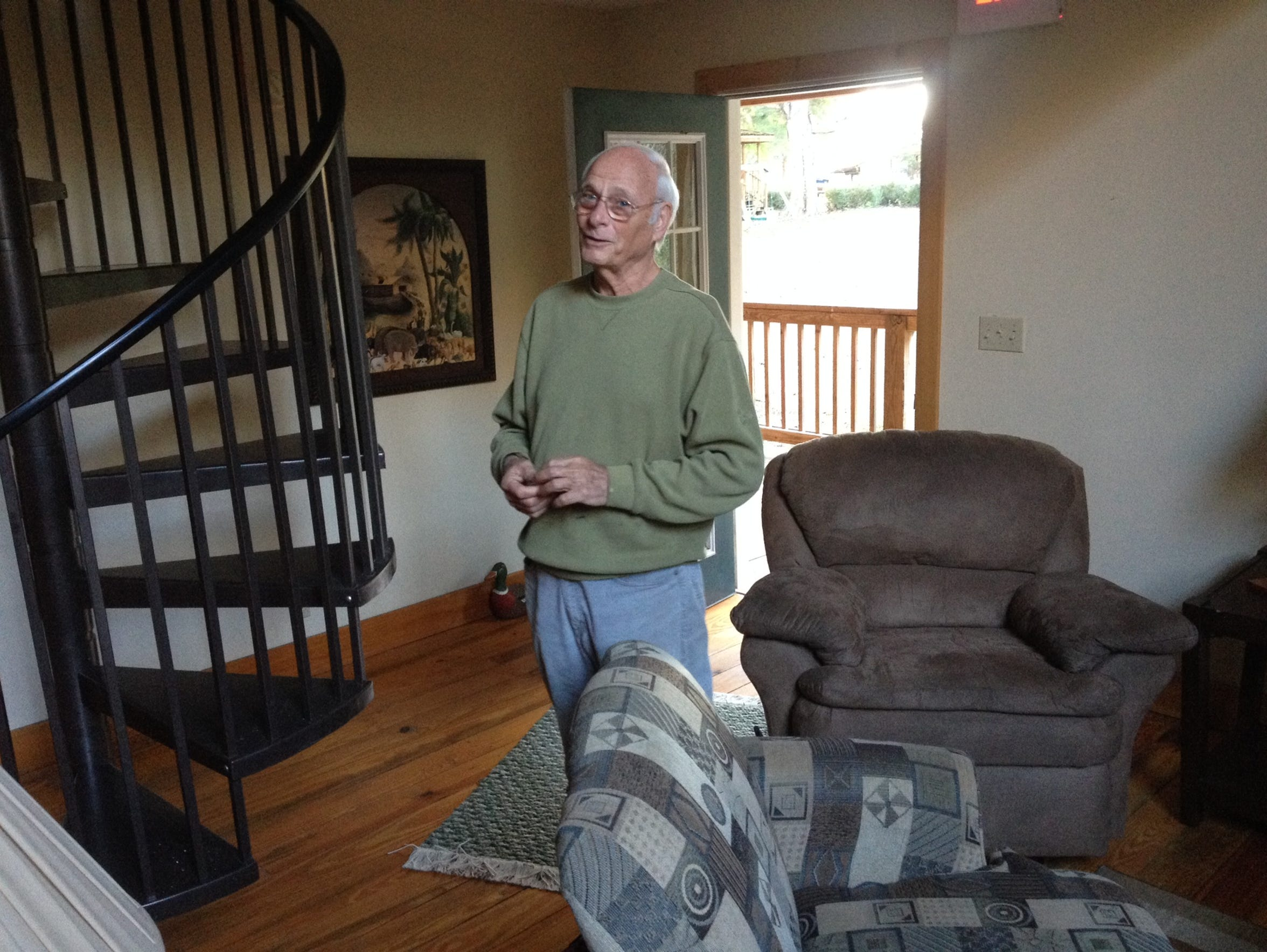 David Taunton, standing in the cottage where Myron