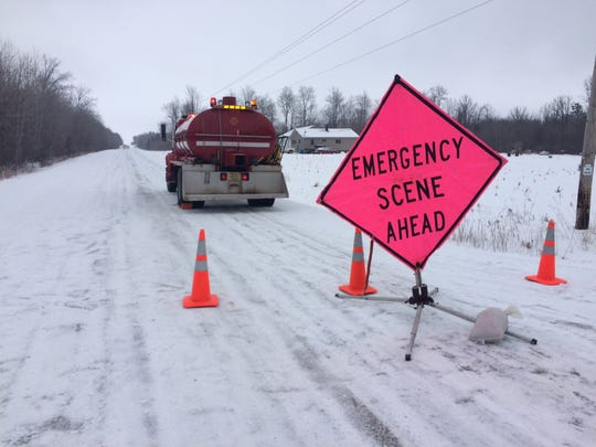 Emergency scene ahead sign is seen at the intersection of Center Road and Cardinal Avenue.