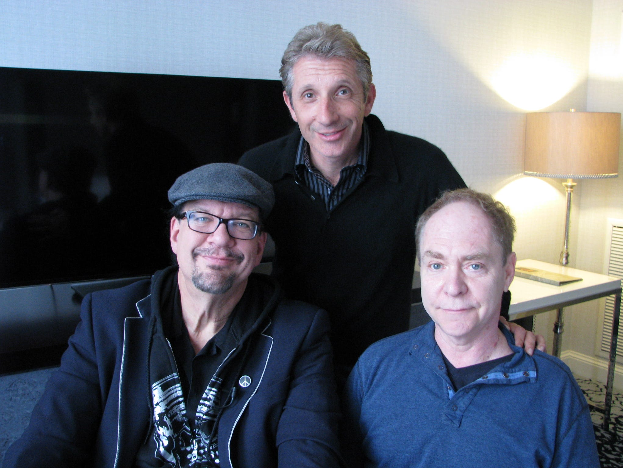 Magicians Penn Jillette (left) and his partner Teller (right) with reporter Marco della Cava (center). Penn & Teller were in San Francisco Tuesday Feb. 3, 2015 to be honored at a comedy festival.