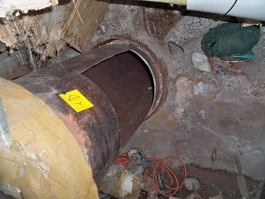 The note was left next to a segment of pipe that had been cut through with a power tool.