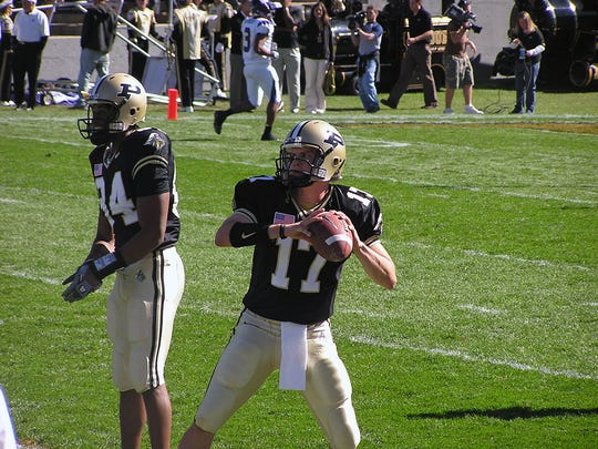 Father Thomas Haan played football at Purdue, but soon felt a higher calling.