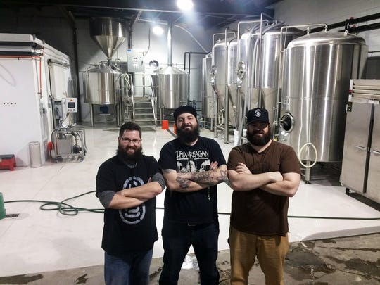 The founders of Central State Brewing, from left, Chris Bly, Josh Hambright and Jake Koeneman.