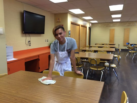 Student Antwan Apachito cleans up after Thursday lunch.