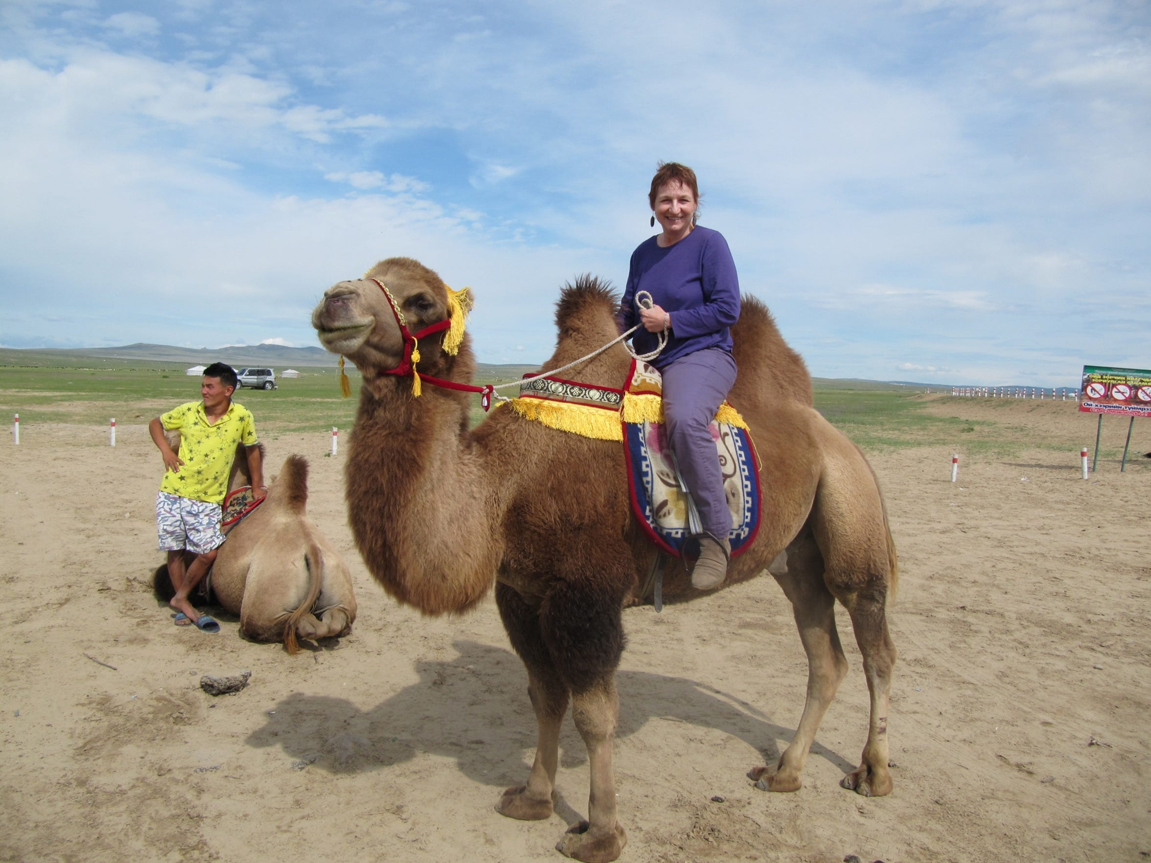 Lisa Jacenich riding a camel in Mongolia, Aug. 2012.