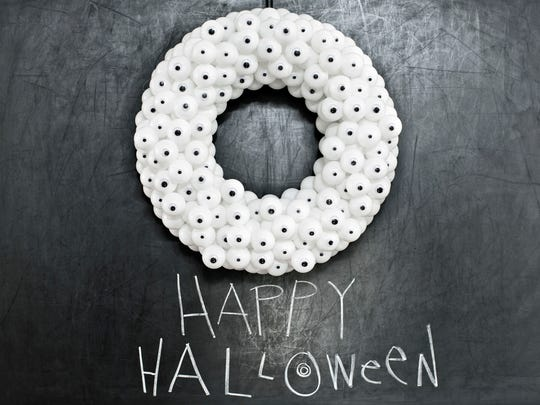 A googly-eyed wreath is a fun one for kids: Cover a