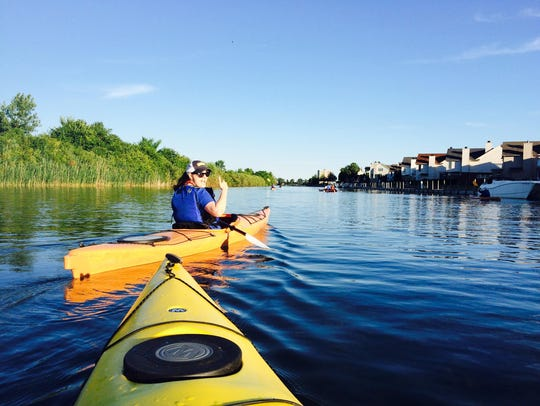 Adrienne Mahan of Detroit paddles with friends down