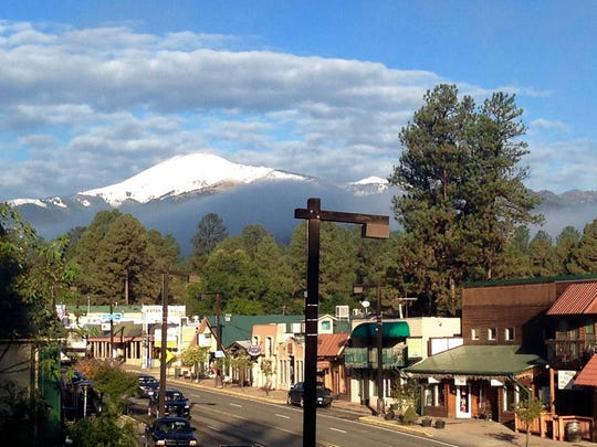 Sierra Blanca Peak looms white above midtown Ruidoso.