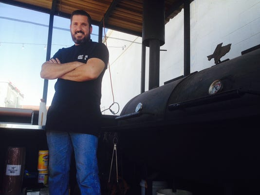 Desert Oak Barbecue owner Richard Funk stands next to a smoker at his food truck. He now owns a restaurant in East El Paso.