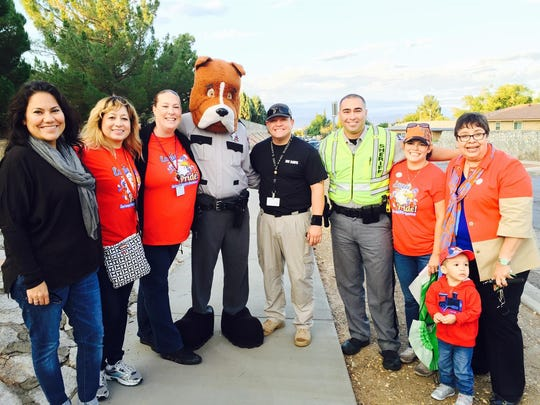 Members of the Eastwood Heights PTA pose with Deputy Dawg, County Judge Veronica Escobar and city Rep. Lily Limón.