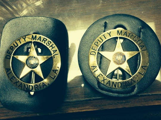 Norris Greenhouse Jr. and Derrick Stafford had to turn in their Alexandria deputy city marshal badges after a fatal shooting incident in Marksville.
