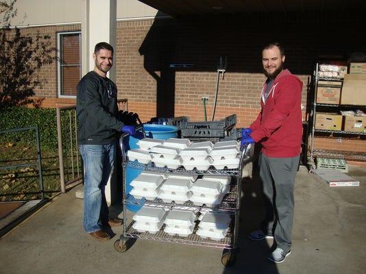 Volunteers help with food handling