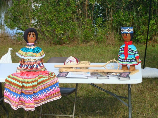 The Swamp Heritage Festival at Big Cypress National Preserve features displays that educate about the Native American history of the area.