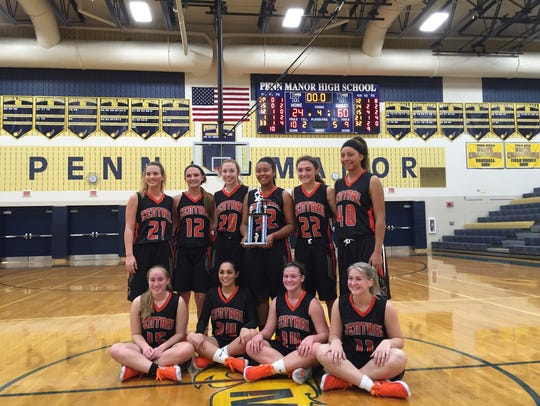 The Central York Panthers pose after winning the Penn