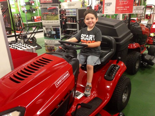 Dylan chose the lawn mower section of Sears above meeting Santa at the Acadiana Mall last weekend.