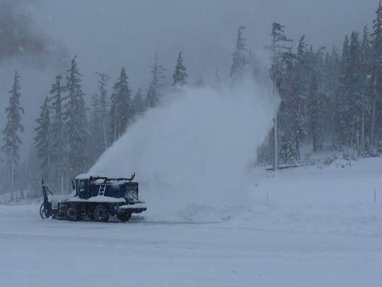 A plow clears snow at Mount Bachelor ski area in Central Oregon.