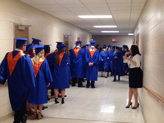 Graduates get lined up in Guinn Auditorium about 30 minutes before Louisiana College's 159th commencement ceremony on Saturday.