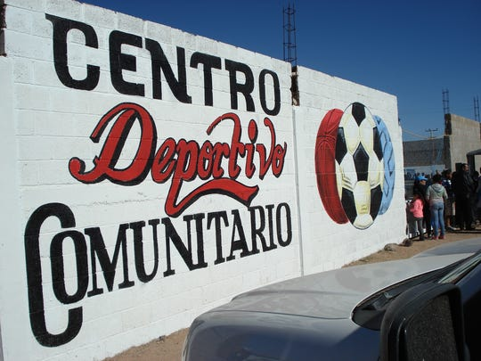 A sign in front welcomes visitors to the new sports complex in Palomas, Mexico.