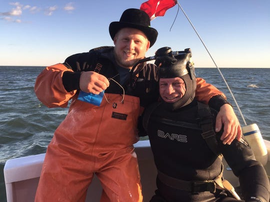 Jay Bradford, (left) of Point Pleasant and Mark Thompson of Dive and Salvage, Sea Bright on the charter boat Lock-N-Load after Thompson recovered Bradford's wedding ring.