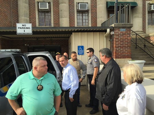 Derrick Stafford (center, in vest) leaves the Avoyelles Parish Courthouse in Marksville after pleading not guilty Tuesday to second-degree murder and attempted second-degree murder. Stafford is being held in Rapides Parish, but his attorney again has asked for his $1 million bond to be reduced.