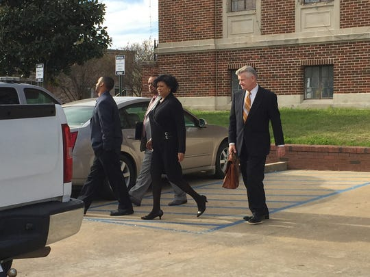 Norris Greenhouse Jr. (left) walks away from the Avoyelles Parish Courthouse on Tuesday with his mother and father, Cheryl and Norris Greenhouse, and his defense attorney (right), George Higgins III.