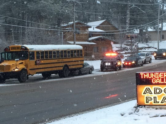Police say nobody was seriously hurt when a sedan wedged itself beneath a school bus on Mechem near the intersection with Sudderth as snow began falling Thursday evening.