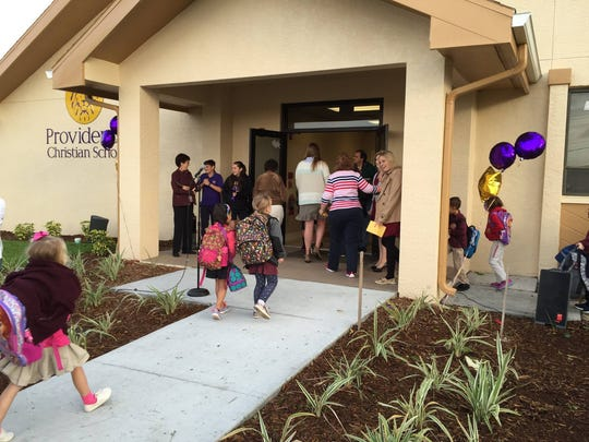 Parents and students enter the new addition to Providence Christian School in Cape Coral.