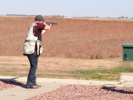 Club member John Greaves, a 2014 Simpson College graduate, shoots trap at a Simpson College Shooting Sports Club Invitation Event.