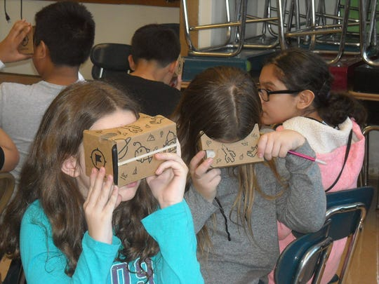 The Google Cardboard system allows students to view a video in all directions, with the camera turning as their head does.
