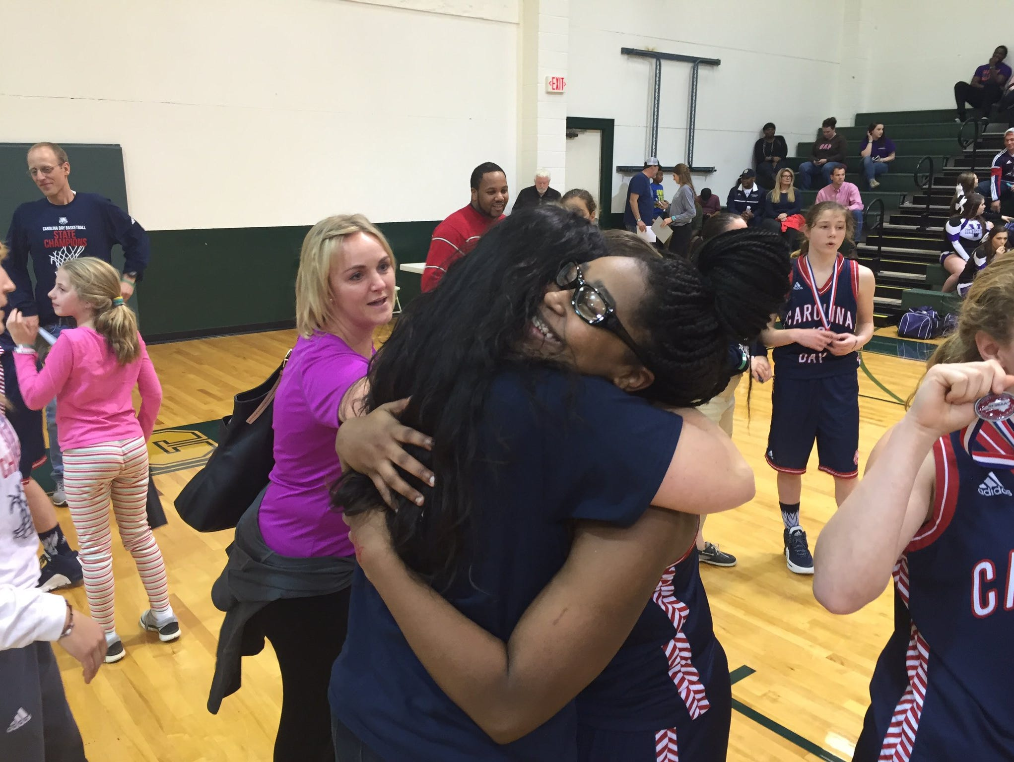 Mikayla Ray, right, and the Carolina Day girls won their sixth consecutive NCISAA 2-A basketball championship on Saturday in Raleigh.