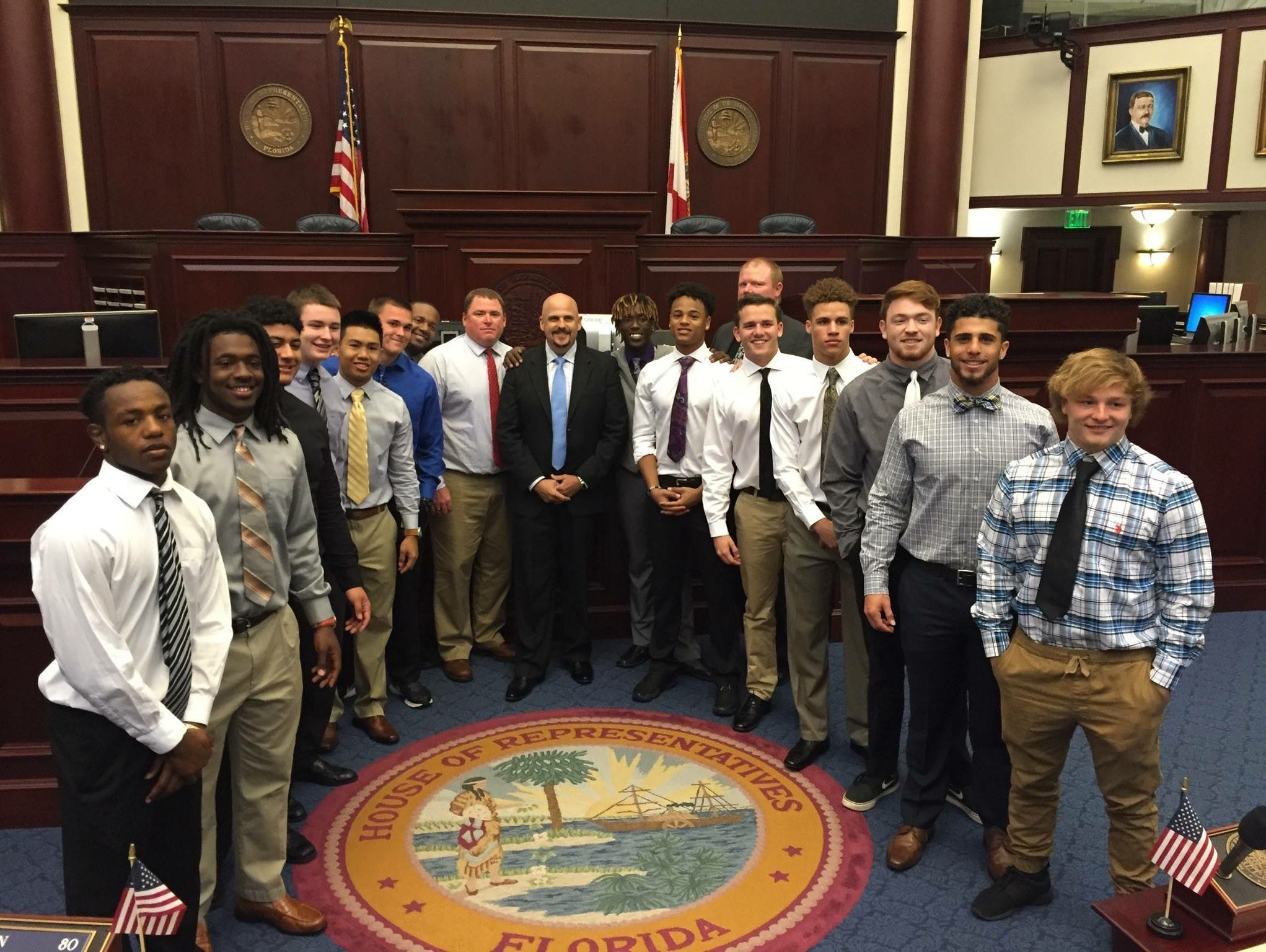 Members of the Viera High football team join state Rep. Ritch Workman in legislative chambers on Tuesday.