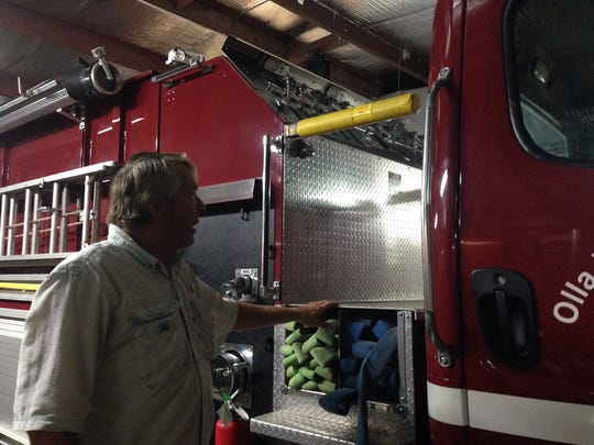 Olla Volunteer Fire Department Chief Joe Thompson looks at one of his newer trucks. Thompson said he once had a potential volunteer who discovered he wouldn't be able to drive a truck because it was a manual transmission.