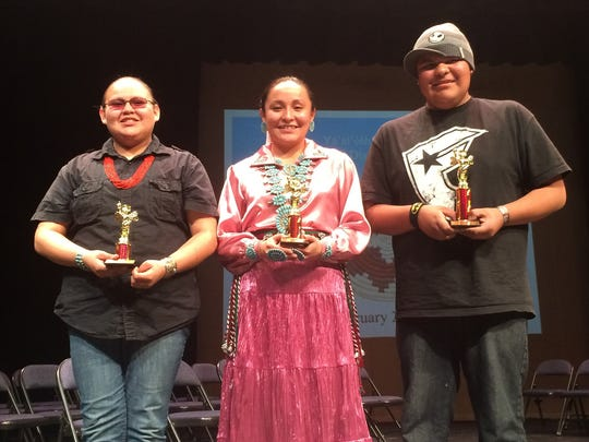 From right, Piedra Vista High School junior Harlem Hollie, Farmington High School sophomore NavaFarrah Duncan and Piedra Vista High School freshman Jametris Rainelynn Saltwater stand for a photo after the Seventh Annual Navajo Spelling Bee on Feb. 24 at Piedra Vista High School in Farmington.  Hollie was the first-place winner of the spelling bee in the high school school category. Duncan was second, and Saltwater was third.