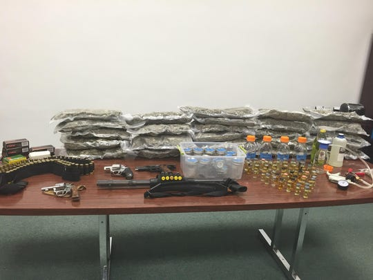Police seized drugs, guns and ammunition.
