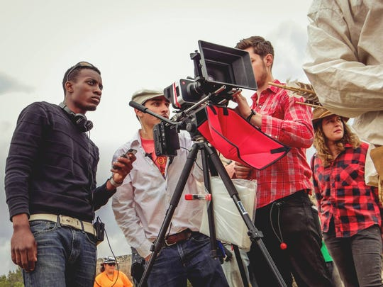"Director Julian Alexander, left, on the set of his short film, ""Buffalo."" Alexander is a graduate of NMSU's Creative Media Institute, and ""Buffalo"" was recently selected to be screened at the Cannes Film Festival. Also pictured, from left to right, are crew members Andrew Griego, Dillon Glazebrook and Ilana Lapid."