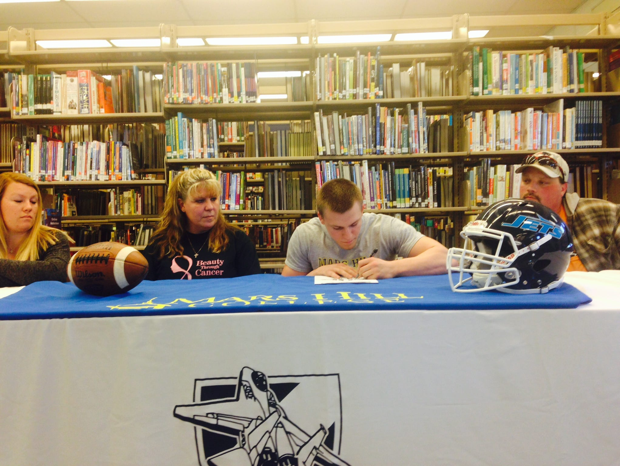 Enka senior Michael Cantrell has signed to play college football for Mars Hill.