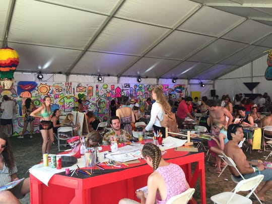 About 200 people were working on crafts at the Coachella Art Studios on Sunday, April 17. In the background, a mural by local artist Sofia Enriquez is embellished by festivalgoers.