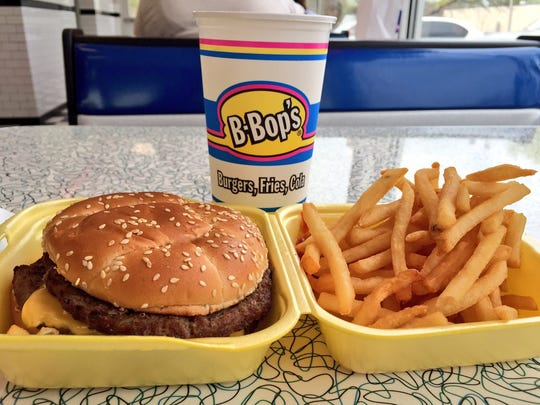 The 1/2 pound cheeseburger meal with a large fry and medium drink from B-Bop's costs $7.60.