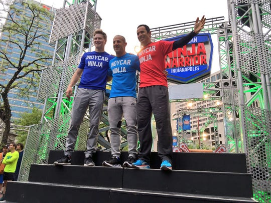 "IndyCar drivers Josef Newgarden, Tony Kanaan and Helio Castroneves pose in front of the ""American Ninja Warrior"" course just after 6 p.m. Wednesday, April 27."