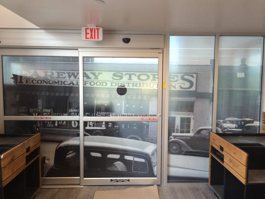 An image of Fareway Stores Inc.'s first Ames store decorates the doors at the new Fareway Meat Market to open May 26 in Omaha.