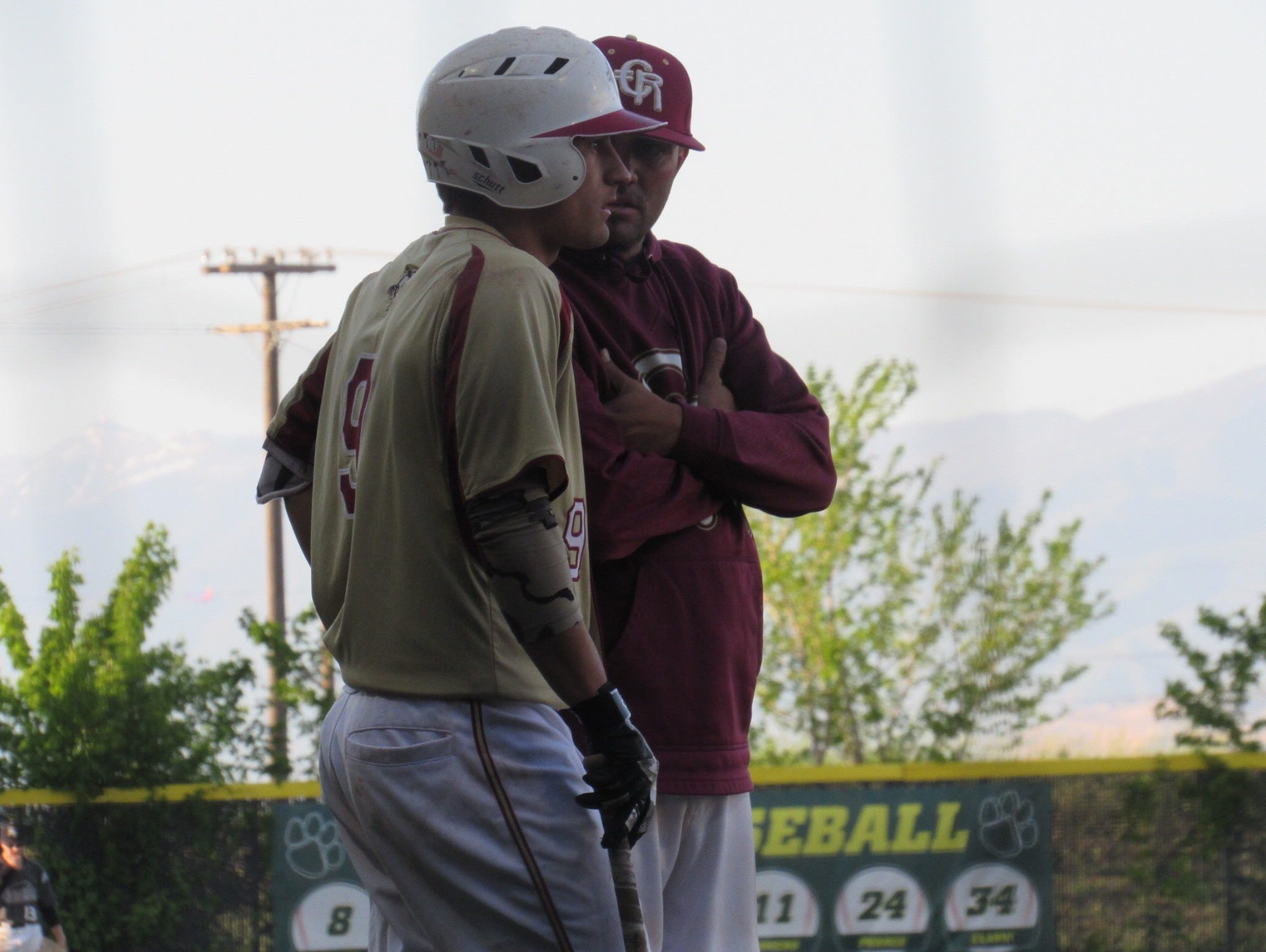 Rykker Tom talks with Cedar coach Eric Fieldsted during the 3A state championship