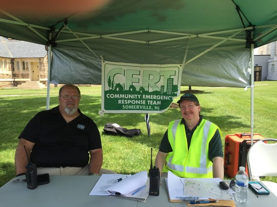 Tony DeMatteo and Pat Mannion  manned the CERT tent, coordinating public safety and recruiting new members.